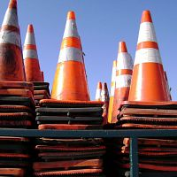 A large stack of orange safety traffic cones