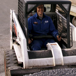 A Photo of David in the skid-steer loader.