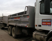 A view of our 14-tonne dump truck attached to its trailer.